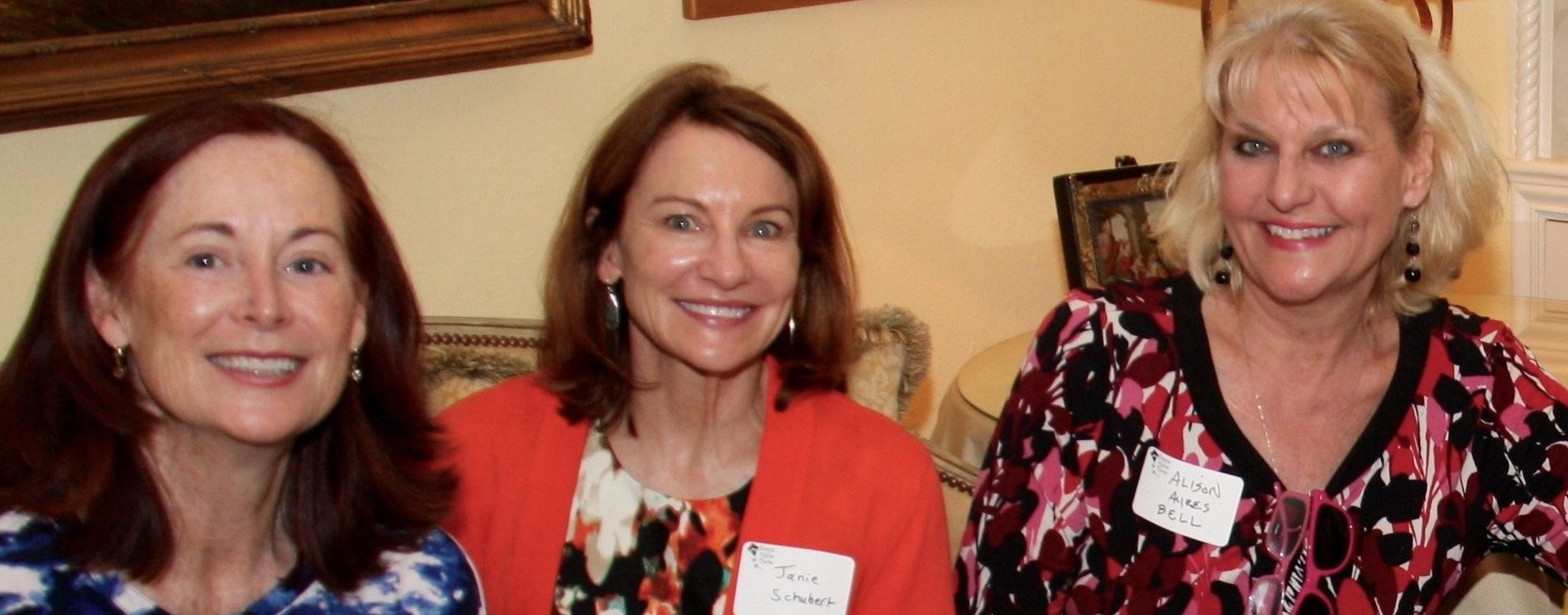 Ruth Hawk, JanieSchubert, and Alison Ayres Bell celebrate Theta's success at the Philanthropic Coffee in March.
