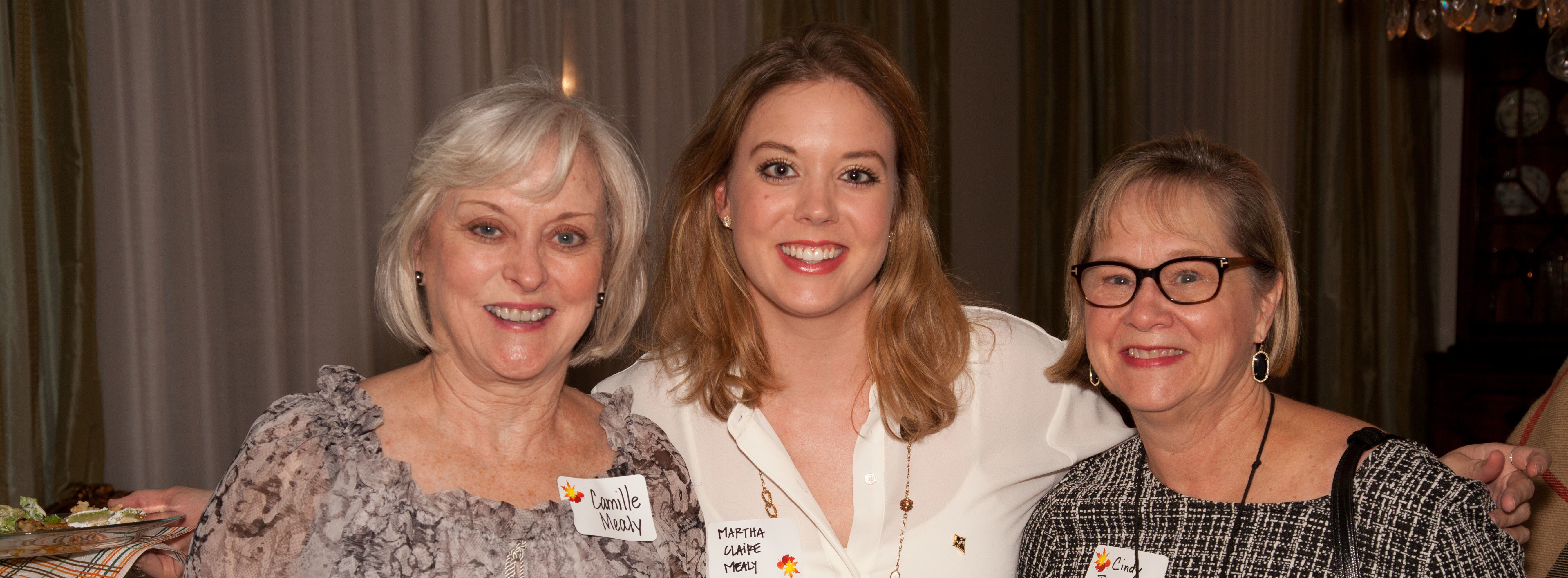 Camille Mealy, Martha Claire Mealy, and Cindy Balderach enjoy visiting at the Fall Feast.