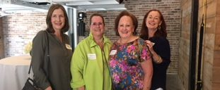 Barbara Gray, Jeannie Osborne, Deborah Dunkum, and Ruth Hawk check out the cool game room at Kite & Key!