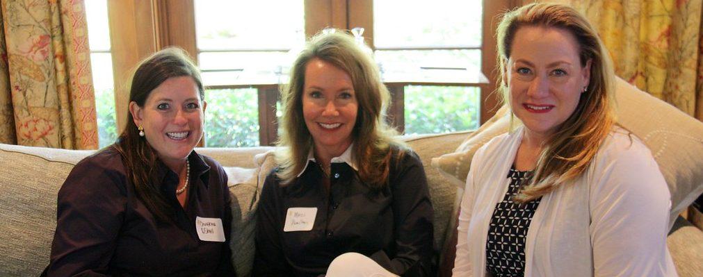 Christina O'Shell, Marci Hamilton, and Rhonda Barclay enjoy visiting at the May Luncheon.